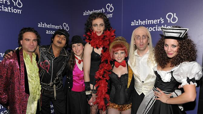"""From left, actors Johnny Galecki, Kunal Nayyar, Mayim Bialik, Jim Parsons, Melissa Rauch, Simon Helberg and Kaley Cuoco, from the cast of """"The Big Bang Theory,"""" pose backstage at the 21st Annual 'A Night at Sardi's' to benefit the Alzheimer's Association at the Beverly Hilton Hotel on Wednesday, March 20, 2013 in Beverly Hills, Calif. (Photo by John Shearer/Invision for Alzheimer's Association/AP Images)"""