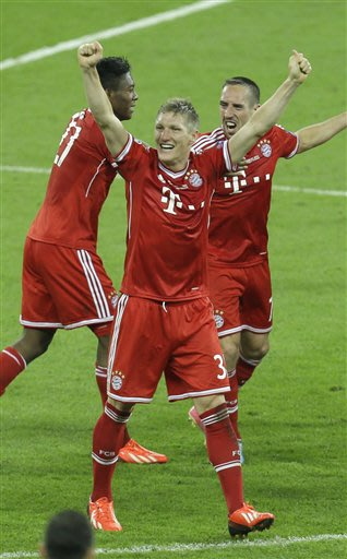 Bayern's David Alaba of Austria, Bastian Schweinsteiger and Bayern's Franck Ribery of France, from left, celebrate winning the Champions League Final soccer match between  Borussia Dortmund and Bayern