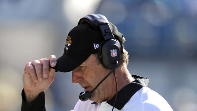 Jacksonville Jaguars coach Mike Mularkey walks the sidelines during the second half of an NFL football game against the Detroit Lions, Sunday, Nov. 4, 2012, in Jacksonville, Fla. Detroit won 31-14. (AP Photo/Stephen Morton)