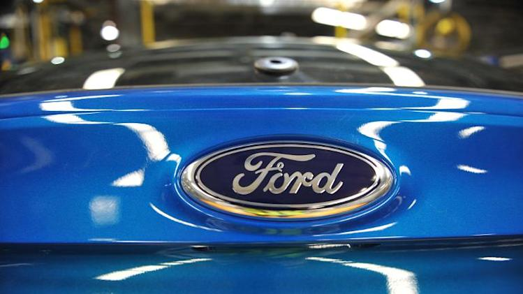 The Ford logo is seen on a newly-built Ford Focus at Ford's Michigan Assembly Plant on October 1, 2013, in Wayne, Michigan
