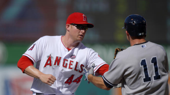 Los Angeles Angels first baseman Mark Trumbo, left, tags out New York Yankees' Brett Gardner who runs to first during the first inning of their baseball game on Saturday, June 15, 2013, in Anaheim, Calif.  (AP Photo/Mark J. Terrill)