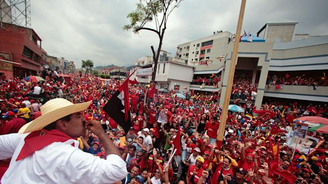 In this photo released by Miraflores Press Office, Venezuela's acting President Nicolas Maduro, left, greets supporters during a campaign rally in Trujillo, Venezuela, Wednesday, April 10, 2013. Maduro, the hand-picked successor of the late President Hugo Chavez, is running for president against opposition candidate Henrique Capriles. The presidential election is set for Sunday, April 14. (AP Photo/Miraflores Press Office)