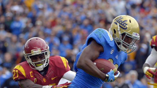 UCLA running back Johnathan Franklin, right, runs in for a touchdown as Southern California cornerback Nickell Robey defends during the first half of their NCAA college football game, Saturday, Nov. 17, 2012, in Pasadena, Calif. (AP Photo/Mark J. Terrill)