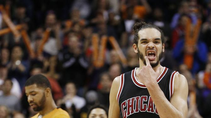 Chicago Bulls' Joakim Noah (13) and Derrick Rose (1) walk down the court after Phoenix Suns' Markieff Morris (11) was fouled during the second half of an NBA basketball game Friday, Jan. 30, 2015, in Phoenix. The Suns defeated the Bulls 99-93. (AP Photo/Ross D. Franklin)