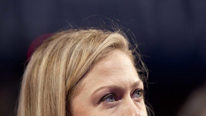 Chelsea Clinton listens to her father, former U.S. President Bill Clinton, speak during the Clinton Global Initiative, Sunday, Sept. 23, 2012, in New York. (AP Photo/Mark Lennihan)