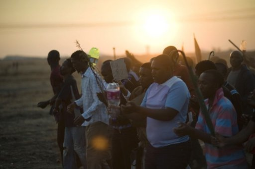&lt;p&gt;Striking Lonmin mine workers are seen in Marikana, South Africa on August 29. Four people were wounded during a shooting Monday at a South African gold mine in the east of Johannesburg after fired mineworkers attacked reinstated colleagues, police said.&lt;/p&gt;