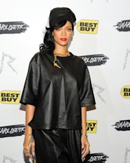 FILE - This Nov. 20, 2012 file photo shows singer Rihanna at a fan meet and greet at the Best Buy Theater in New York. Rihannas collection for British brand River Island is slated for its debut next month during London Fashion Week. Fashion week organizers listed the pop star on its official calendar of fall previews as they sent out registration materials on Thursday to the editors, stylists and retailers who cover designer collections. The 24-year-olds first collection of clothing and accessories will be shown Feb. 16. (Photo by Evan Agostini/Invision/AP, file)