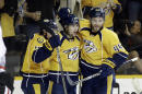 Nashville Predators center Filip Forsberg (9), of Sweden, is congratulated by Craig Smith, left, and Cody Franson (44) after Forsberg scored a goal against the Chicago Blackhawks during the third period of Game 2 of an NHL Western Conference hockey playoff series Friday, April 17, 2015, in Nashville, Tenn. (AP Photo/Mark Humphrey)