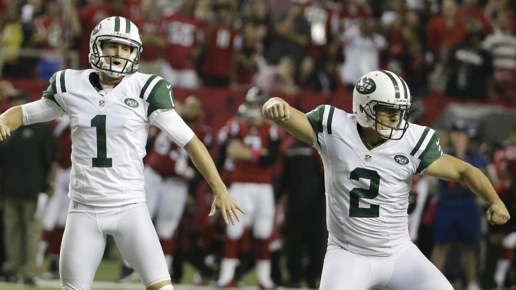New York Jets kicker Nick Folk (2) celebrates his field goal with Ryan Quigley (1) against the Atlanta Falcons during the second half of an NFL football game, Monday, Oct. 7, 2013, in Atlanta. The Jets won 30-28. (AP Photo/David Goldman)