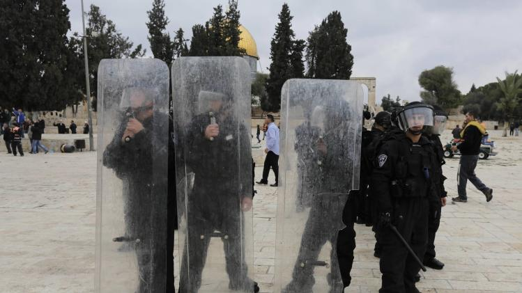 Israeli police hold their shields during clashes with stone-throwing protesters in Jerusalem's Old City