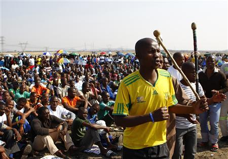 Miners sing as they gather at Lonmin's Marikana mine in South Africa's North West Province September 14, 2012.