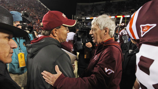 Florida State coach Jimbo Fisher, left, and Virginia coach, Frank Beamer greet each other after an NCAA college football game in Blacksburg, Va., Thursday, Nov. 8, 2012. Florida State won 28-22. (AP Photo/Steve Helber)