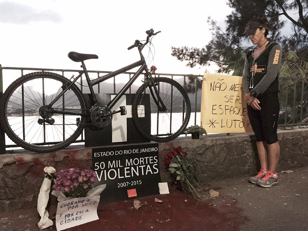Memorial for stabbed doctor in Brazil amid fresh violence