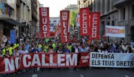 <p>Proesters are seen attending a demonstration, organized by Unions, on June 20, in Barcelona, against the government's welfare cuts, to reject the new Labor Reform and to demand other economic and social policy response to the crisis.</p>