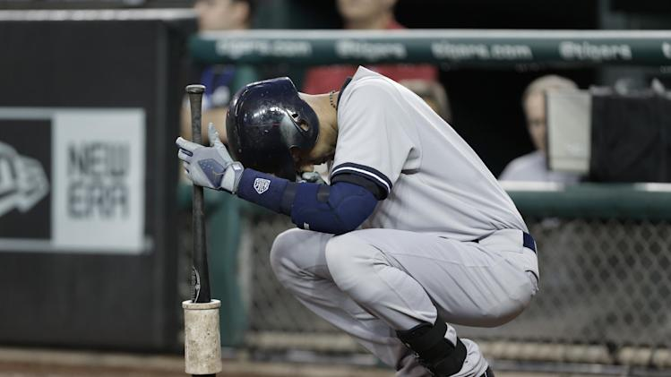 New York Yankees' Derek Jeter pauses before batting against the Detroit Tigers in the first inning of a baseball game in Detroit Tuesday, Aug. 26, 2014. (AP Photo/Paul Sancya)