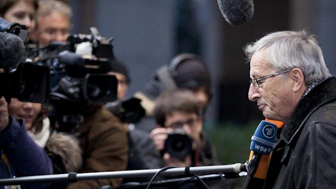 Luxembourg's Prime Minister Jean-Claude Juncker, right, speaks with the media as he arrives for an EU summit in Brussels on Thursday, Dec. 13, 2012. In one whirlwind morning, the European Union nations agreed on the foundation of a fully-fledged banking union and Greece's euro partners approved billions of euros in bailout loans that will prevent the nation from going bankrupt. (AP Photo/Virginia Mayo)
