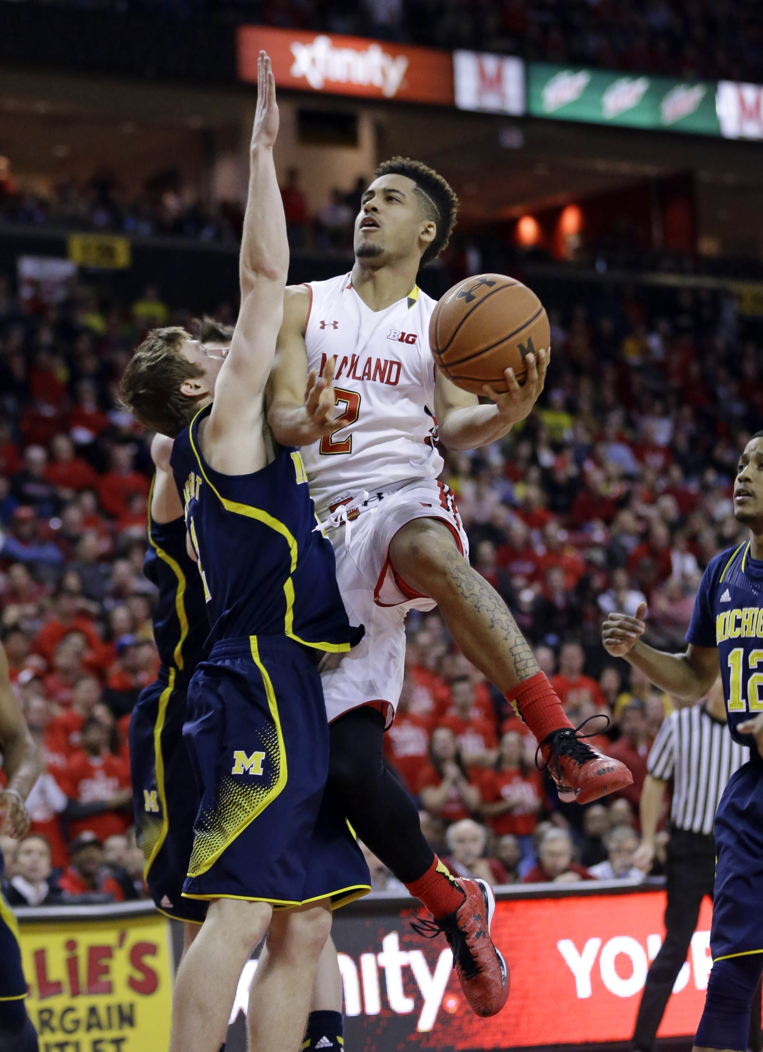 No. 14 Maryland beats Michigan 66-56 for 5th straight win