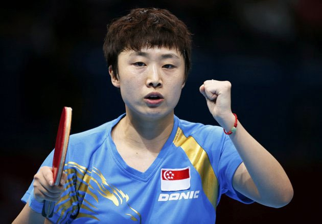Politicians, actors, ordinary Singaporeans congratulate Feng Tianwei for winning the bronze in the London 2012 Olympic Games. (Reuters photo)