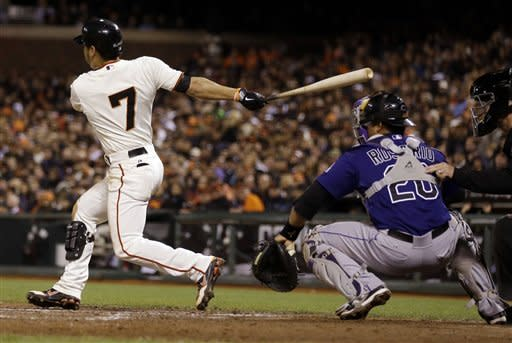 Cain, Sandoval lead Giants past Rockies 7-1