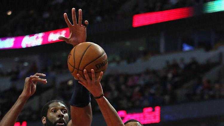 Wall and Nene lead Wizards over Bulls, 102-88