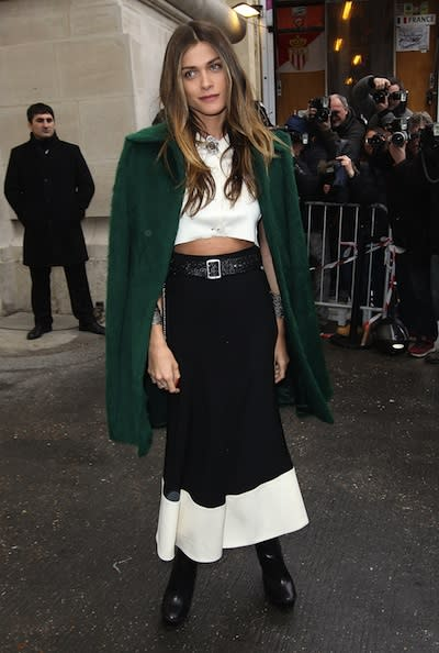 For the boho babes, show a flash of tummy in an alternatively sexy black-and-white ensemble. A long, belted skirt and leather boots feel very hippie-inspired, while the jeweled crop top and emerald co