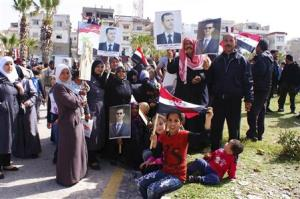 Supporters of Syrian President Bashar al-Assad attend a rally to support him and the army, at the coastal city of Jableh in Lattakia