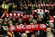 Liverpool supporters hold scarves heralding manager Kenny Dalglish at Anfield in 2011. Kenny Dalglish called on Liverpool&#39;s supporters to rally behind the club on Thursday following his shock sacking as manager of the Premier League giants