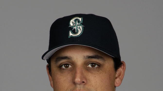 FILE - In this Feb. 21, 2012, file photo,  Seattle Mariners' Jason Vargas poses in a baseball uniform in Peoria, Ariz. The Los Angeles Angels have traded power hitter Kendrys Morales to the Mariners for left-hander Vargas. (AP Photo/Charlie Riedel, File)