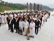 Unification Church devotees wait in line to mourn the death of founder Sun Myung Moon in Gapyeong. Buses ferried mourners into the Gapyeong complex where a special altar bearing a giant portrait of Moon had been erected inside a stadium