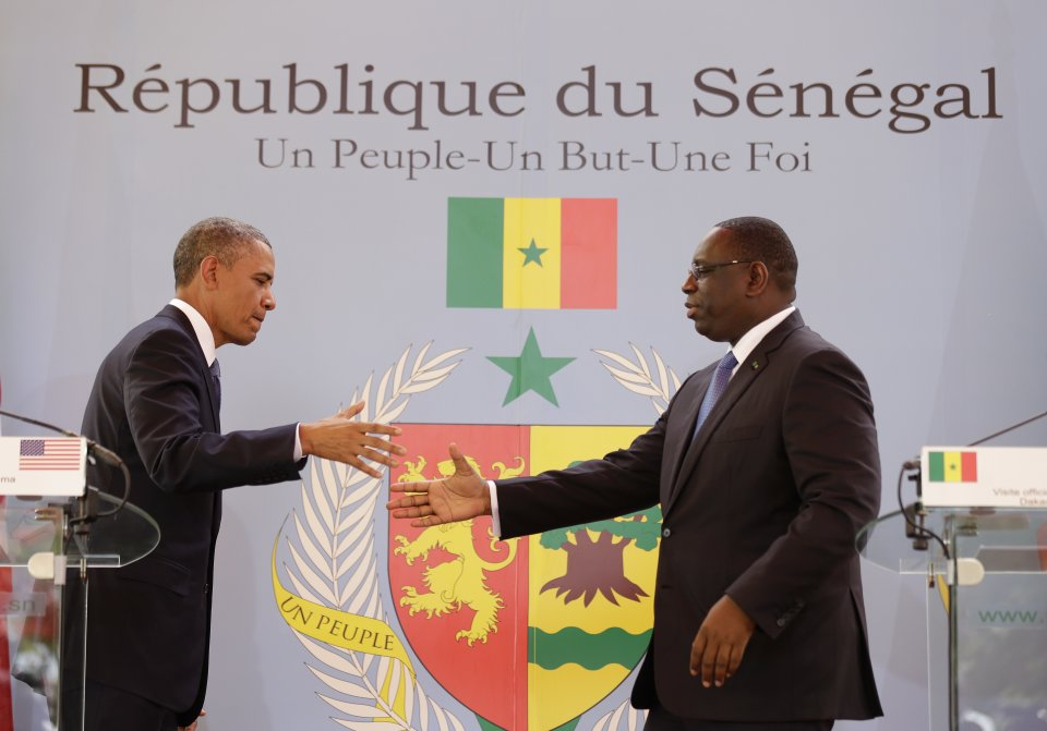 U.S. President Barack Obama, left, shakes hands with Senegalese President Macky Sall after a joint press conference at the presidential palace in Dakar, Senegal, Thursday, June 27, 2013. President Obama arrived in Senegal Wednesday night to kick off a weeklong trip to Africa, a three-country visit aimed at overcoming disappointment on the continent over the first black U.S. president's lack of personal engagement during his first term. (AP Photo/Rebecca Blackwell)
