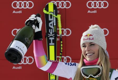 Lindsey Vonn of the U.S. celebrates with champagne on the podium after winning the women's World Cup Super-G skiing race in Cortina D'Ampezzo