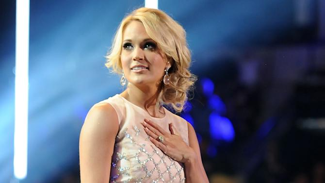 FILE - This June 5, 2013 file photo shows Carrie Underwood at the 2013 CMT Music Awards at Bridgestone Arena in Nashville, Tenn. Underwood will perform at the awards ceremony as part of a tribute to TV's role in significant 1960s events. The Emmys will air at Sunday at 8 p.m. EDT on CBS. (Photo by Frank Micelotta/Invision/AP, File)