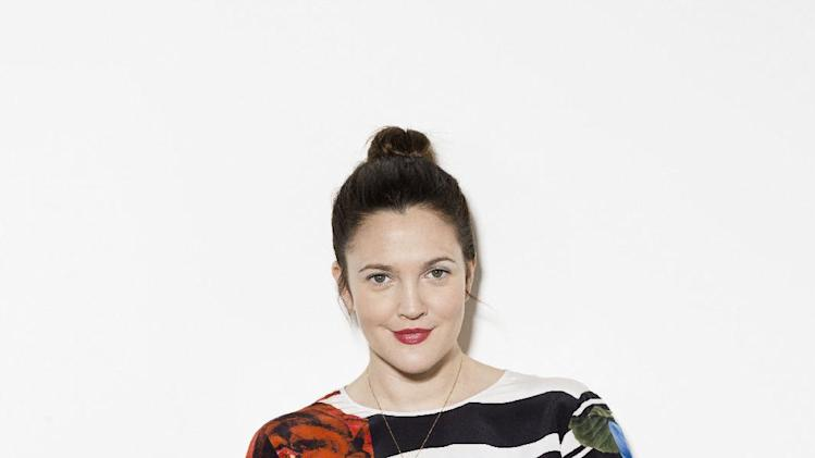 "Drew Barrymore poses for a portrait in promotion of the launch of her new cosmetics line ""Flower"", on Monday, Jan. 14, 2013 at the Maesa offices in New York. (Photo by Victoria Will/Invision/AP Images)"