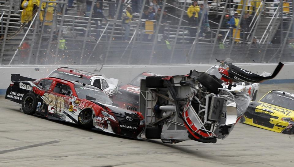 Drivers Joey Logano, left, and Clint Bowyer wreck during the NASCAR Nationwide series 5-hour ENERGY 200 auto race, Saturday, May 14, 2011, in Dover, Del. (AP Photo/Matt Slocum)