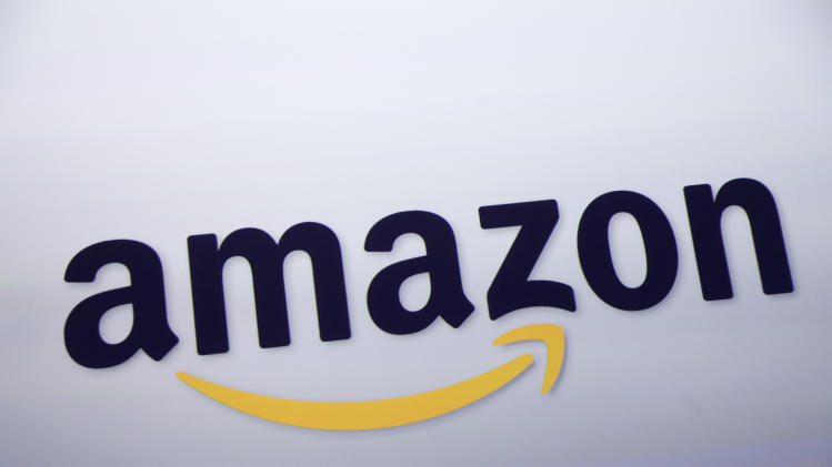 FILE - This Sept. 28, 2011 file photo shows the Amazon logo on display at a news conference in New York. Rumors of an Amazon smartphone reached a fever pitch this week, with several tech blogs speculating that the device could be due out this year. (AP Photo/Mark Lennihan, File)