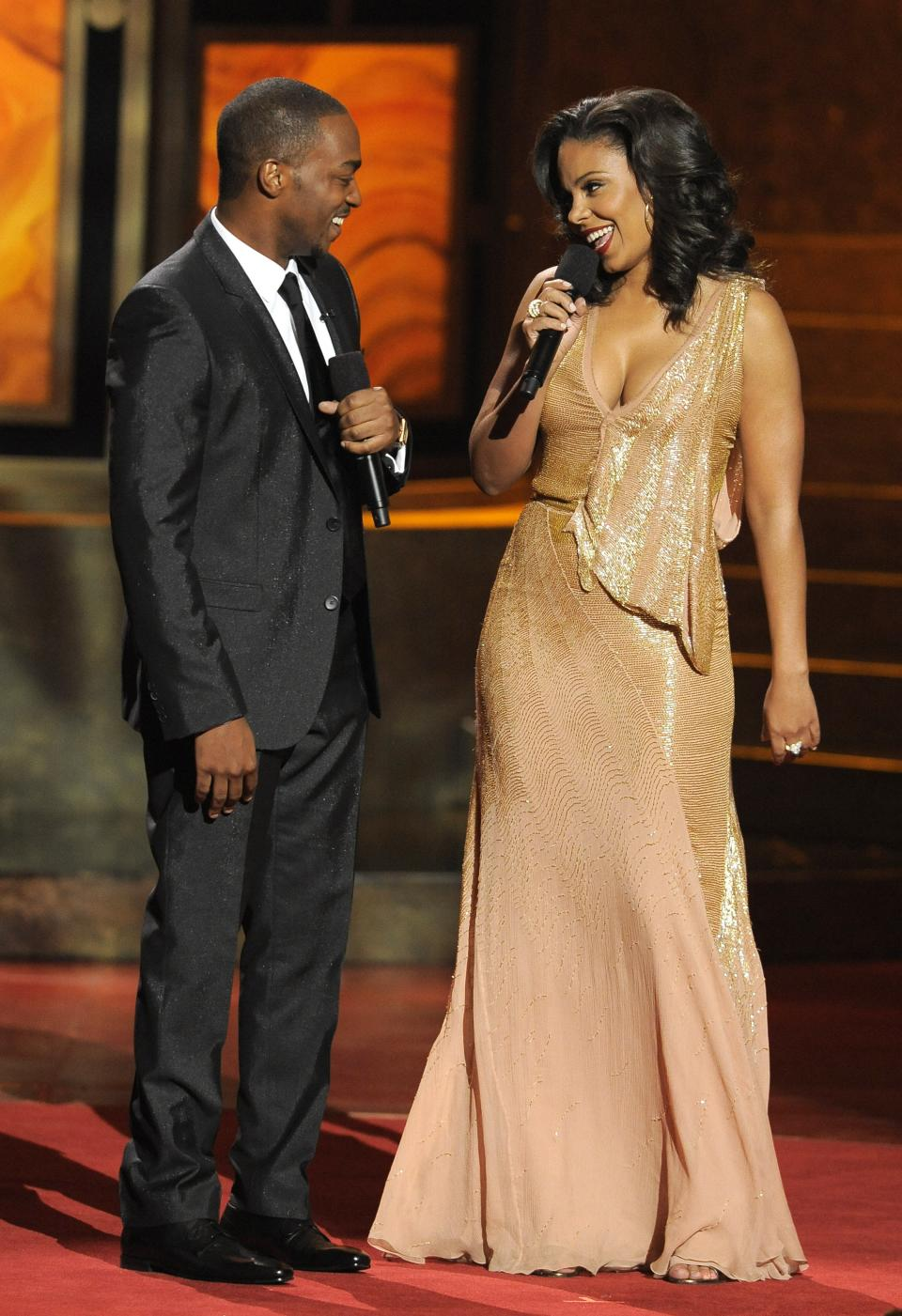 Hosts Anthony Mackie, left, and Sanaa Lathan speak onstage at the 43rd NAACP Image Awards on Friday, Feb. 17, 2012, in Los Angeles. (AP Photo/Chris Pizzello)