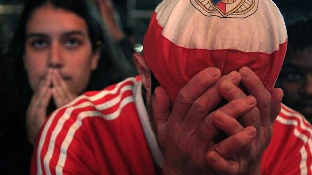 Benfica's fans react while watching their club play against Chelsea during their Europa League match final in Amsterdam (reuters)