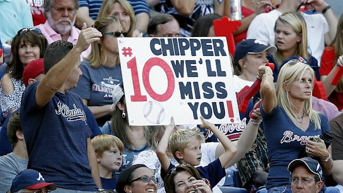Atlanta Braves fans hold a sign during the fourth inning of the National League wild card playoff baseball game between the Braves and the St. Louis Cardinals, Friday, Oct. 5, 2012, in Atlanta. (AP Photo/John Bazemore)