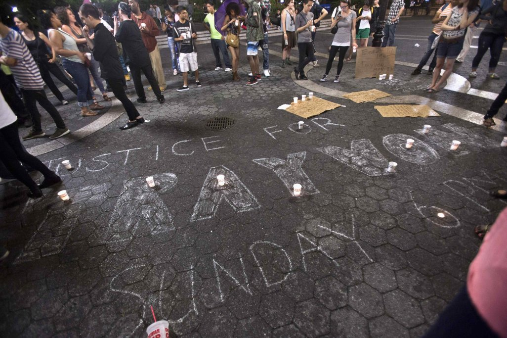 """Justice For Trayvon"" is written on the ground as people gather at Union Square in response to the acquittal of George Zimmerman in the Trayvon Martin trial, in New York"