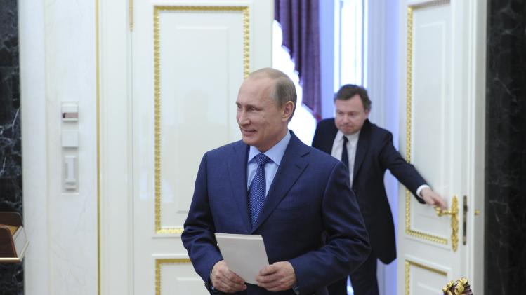 Russian President Vladimir Putin arrives for a meeting of the Security Council in Moscow's Kremlin