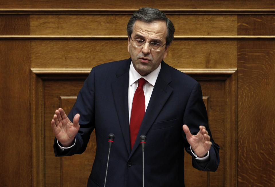 Greek Prime Minister Antonis Samaras speaks at the Parliament during a debate on the new government's policy agenda before staging a vote of confidence in Athens, late Sunday July 8, 2012. (AP Photo/Kostas Tsironis)