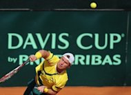 Lleyton Hewitt of Australia plays a ball to Germany&#39;s Cedrik-Marcel Stebe during their Davis Cup World Group play-off tennis match on September 16 in Hamburg, northern Germany. The 21-year-old Stebe, ranked 127th in the world and playing just his third Davis Cup rubber, rallied from 3-0 down in the first set to floor Hewitt 6-4, 6-1, 6-4 in just over two hours at Rothenbaum&#39;s clay-court stadium