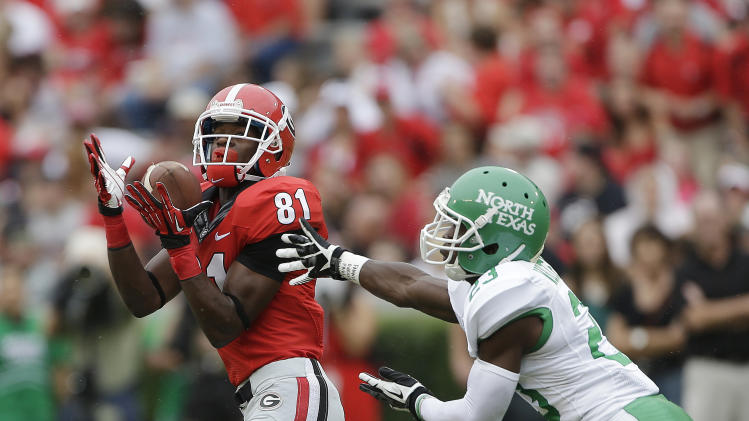 Georgia wide receiver Reggie Davis (81) hauls in a pass for a touchdown as North Texas defensive back Zac Whitfield (23) defends in the first half of an NCAA college football game Saturday, Sept. 21, 2013, in Athens, Ga. (AP Photo/John Bazemore)