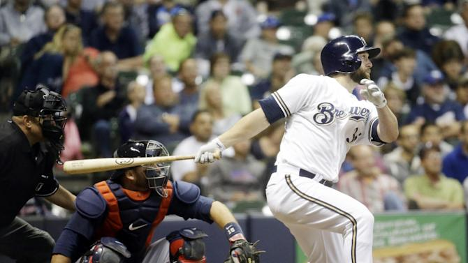 Milwaukee Brewers' Shane Peterson hits an RBI double during the seventh inning of a baseball game against the Atlanta Braves Tuesday, July 7, 2015, in Milwaukee. (AP Photo/Morry Gash)