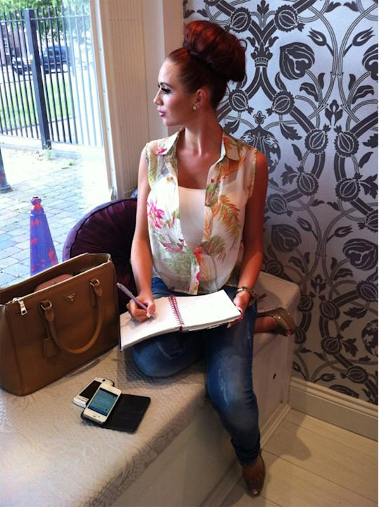 Celebrity photos: Amy Childs has been one busy lady recently, what with the launch of her new perfume and boutique. However, she took some time out during a business meeting to tweet this picture, sho