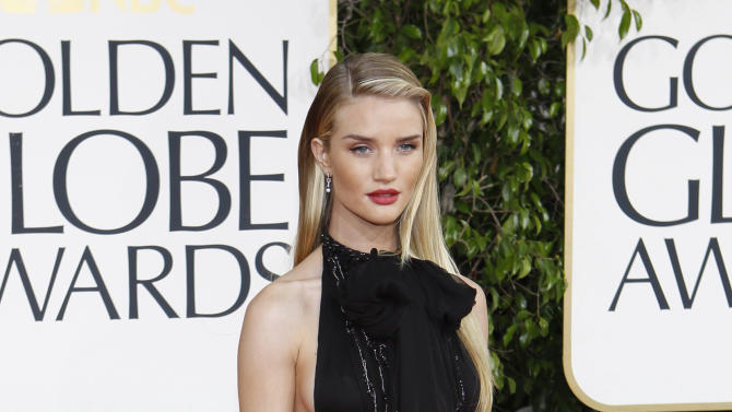 Model Rosie Huntington-Whiteley arrives at the 70th annual Golden Globe Awards in Beverly Hills