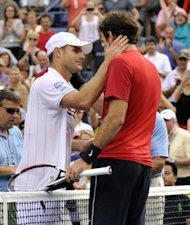 "Andy Roddick (L) greets Juan Martin Del Potro following Roddick's loss in their US Open match on September 5. ""I've loved every minute of it -- for the first time in my career I'm not sure what to say,"" said Roddick, who was in tears after his loss"