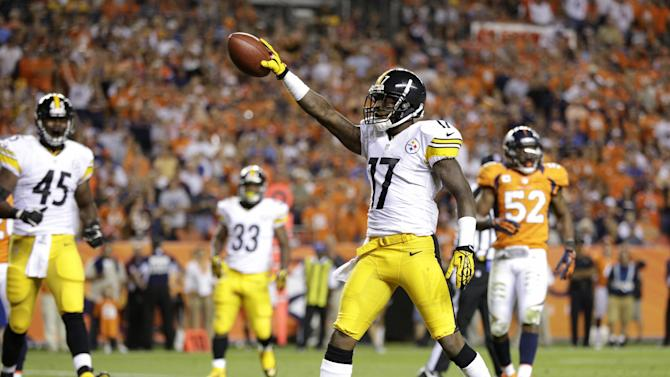 Pittsburgh Steelers wide receiver Mike Wallace (17) celebrates a touchdown against the Denver Broncos during the third quarter of an NFL football game, Sunday, Sept. 9, 2012, in Denver. (AP Photo/Joe Mahoney)