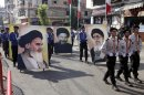 Hezbollah supporters carry pictures, of Iran's supreme leader, Ayatollah Ali Khamenei, right, disappeared Imam Moussa al-Sadr, center, and Iran's Ayatollah Ruhollah Khomeini, left, during a rally to mark the occasion of Jerusalem Day in the southern suburb of Beirut, Lebanon, Friday, Aug 17, 2012. Nasrallah warned Israel that any aggression against Lebanon would be extremely costly and said Hezbollah can transform the lives of millions of Zionists in all of Israel to hell. (AP Photo/Bilal Hussein)