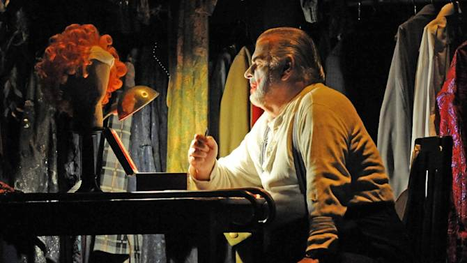 """This Sept. 15, 2010 photo released by Opera Australia shows Alan Opie in the title role of Opera Australia's """"Rigoletto,"""" in Sydney. The first of Giuseppe Verdi's three great middle period triumphs has been shifted before to New York's Little Italy, Federico Fellini's Rome, modern-day Hollywood and even the Oval Office. Now it will take place amid dazzling Sin City lights and not in the Renaissance Palazzo Ducale when Michael Mayer's version of the 162-year-old classic opens Monday night. (AP Photo/Opera Australia, Branco Gaica)"""
